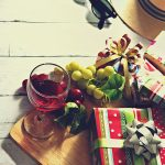 A glass of wine, grape, and presents. Now that your website is ready...
