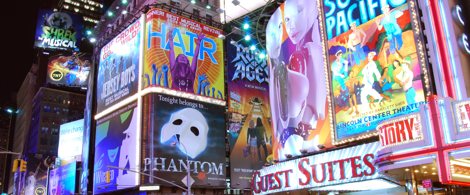 This picture depicts Times Square at night with many of its billboards light.