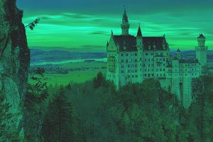 This is the Neuschwanstein Castle with a beautiful orange sunset with the red color removed (i.e. it now looks greenish)